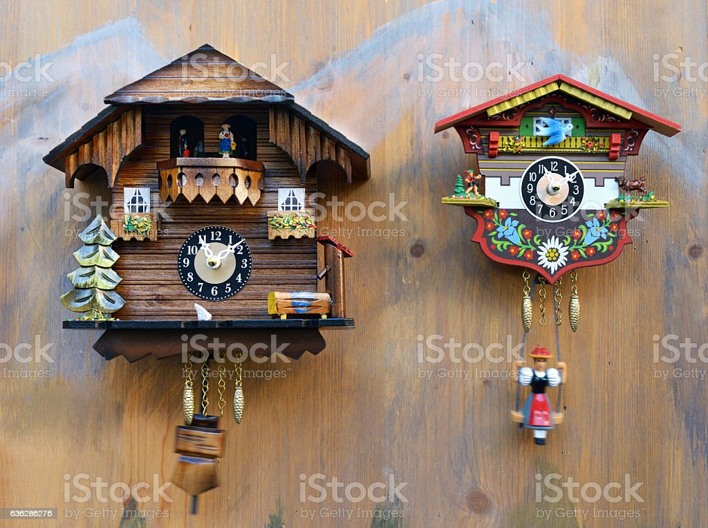 Traditional colorful wooden cuckoo clocks stock photo