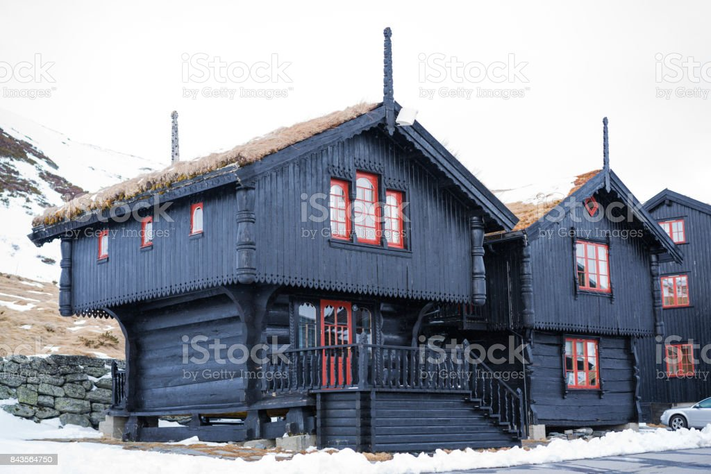 Traditional cottage with grass and moss on roof in central Norway stock photo