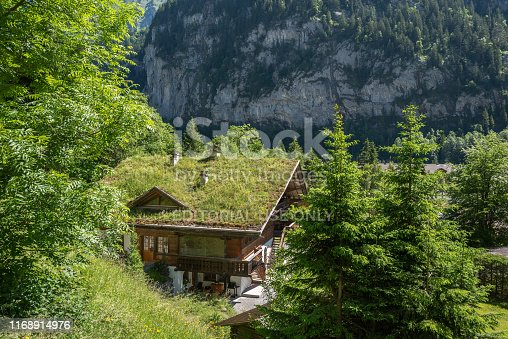 Lauterbrunnen, Switzerland - June 17, 2019: Traditional country house with the use of a grass roof in Lauterbrunnen in the Bernese Oberland in Switzerland