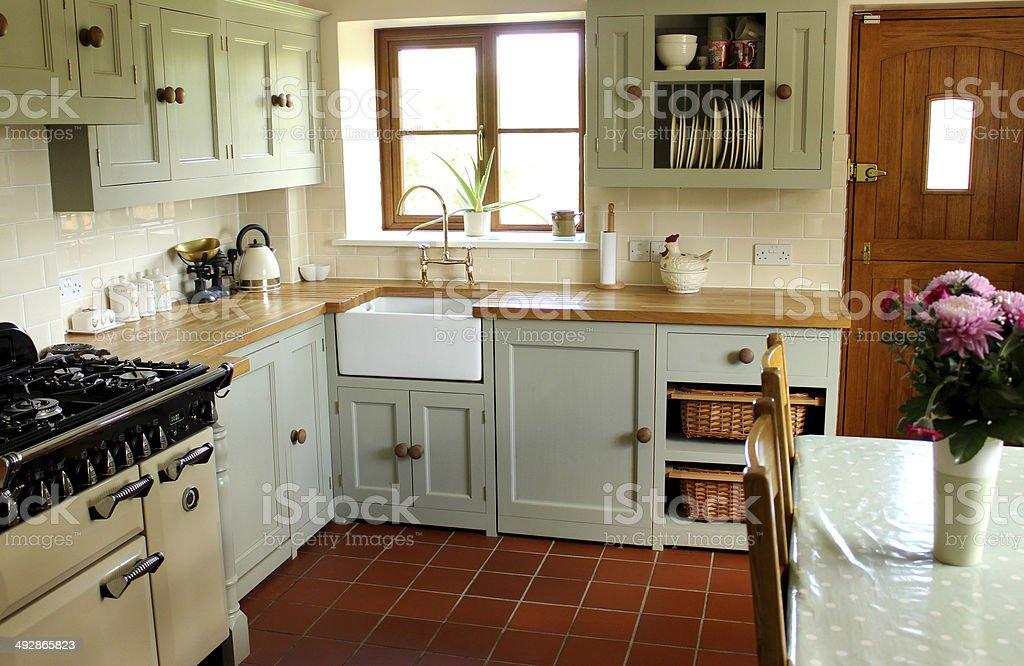Traditional country kitchen, gas range cooker, Belfast sink, wooden worktops stock photo