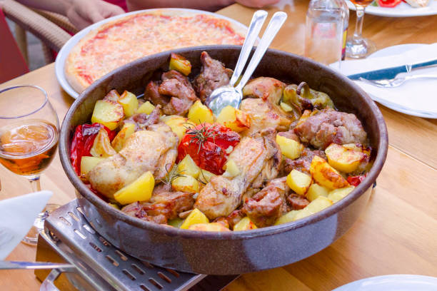 traditional croatian food peka with mix meat and vegetables traditional croatian food peka with mix meat, vegetables and wine croatian culture stock pictures, royalty-free photos & images