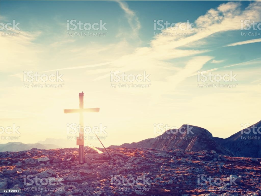Traditional cross at mountain top in Alp. Cross monument to the dead climbers stock photo
