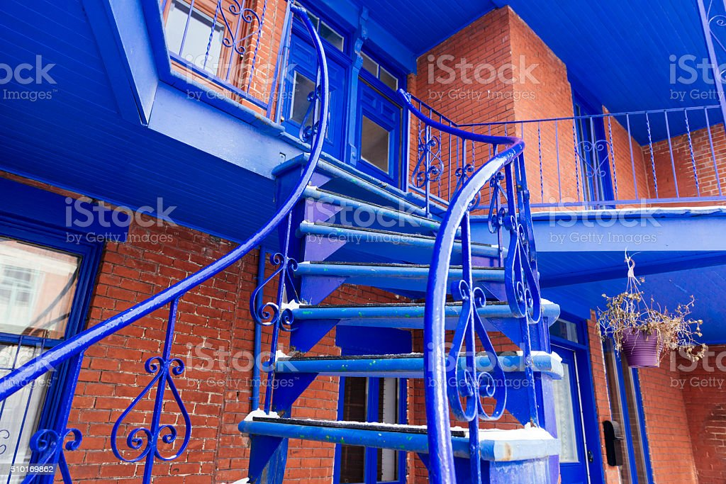 Traditional Curvy Blue Metal Stairs Montreal Architecture in Quebec Canada stock photo