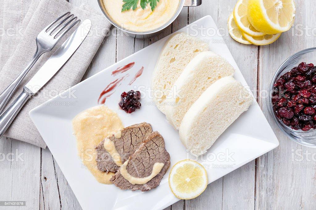 Traditional Czech & Slovak sirloin with cream sauce and dumplings stock photo