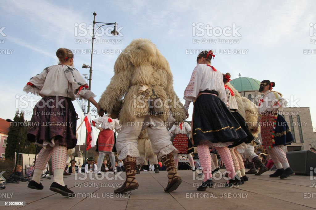 Traditional dance of Sokac ethnic minority during the Busojaras annual carnival in Hungarian town of Mohacs. stock photo