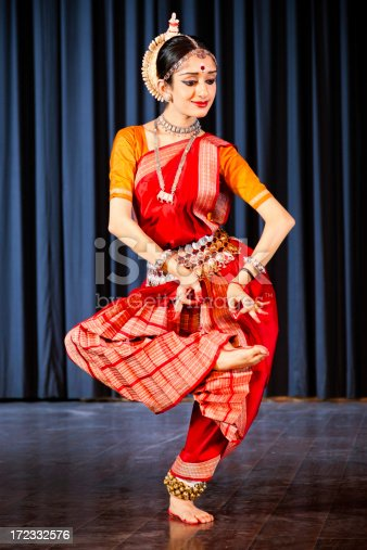 Indian woman dancing traditional danceKuchipudi dancer performing on stage