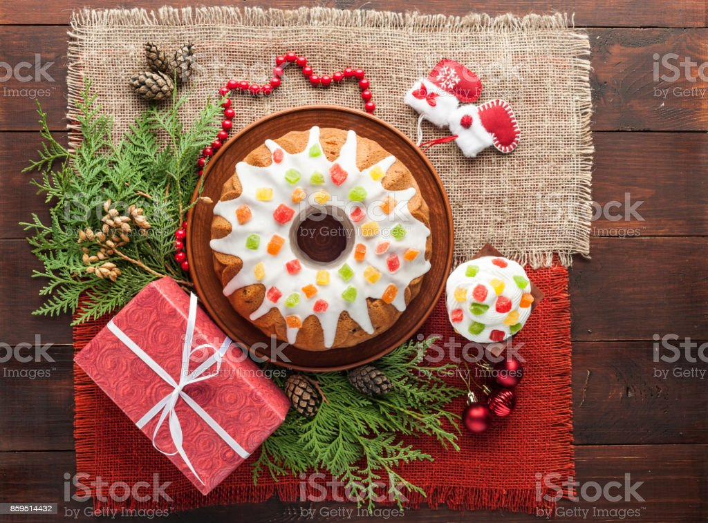 traditional decorated christmas cake at wooden table stock photo