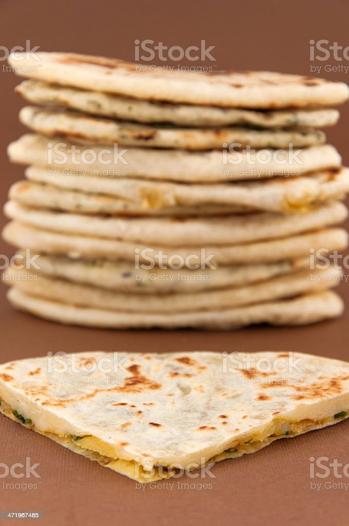 Traditional delicious Indian bread naan, basic and with spinach stock photo