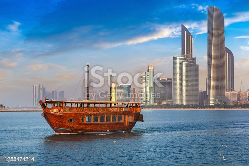 Cruise on traditional Dhow boat in Abu Dhabi in a summer day, United Arab Emirates