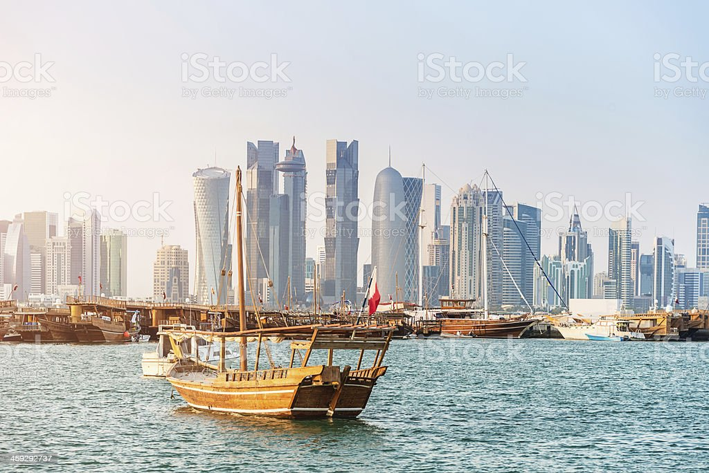 Traditional Dhows in Front of Modern Doha Skyline, Qatar stock photo