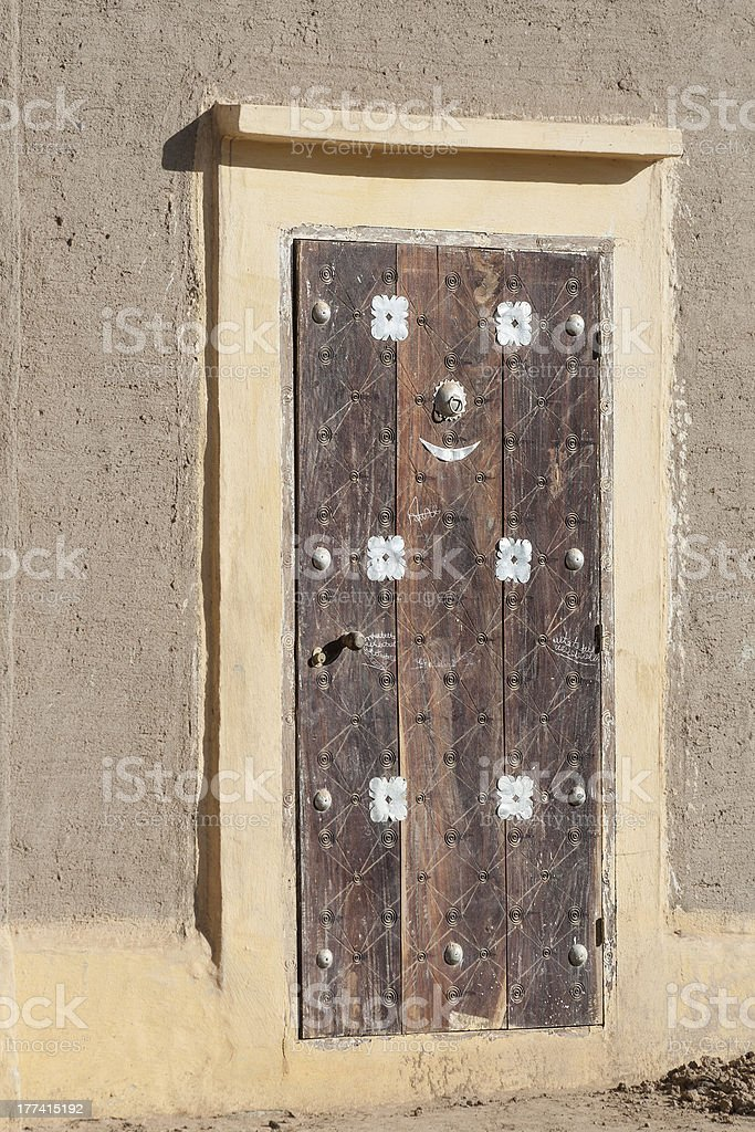 Traditional door, Djenné. stock photo