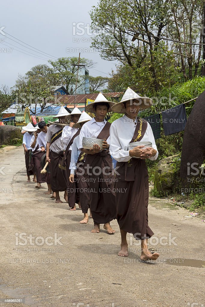 Traditional dressed Burmese men in a procession royalty-free stock photo