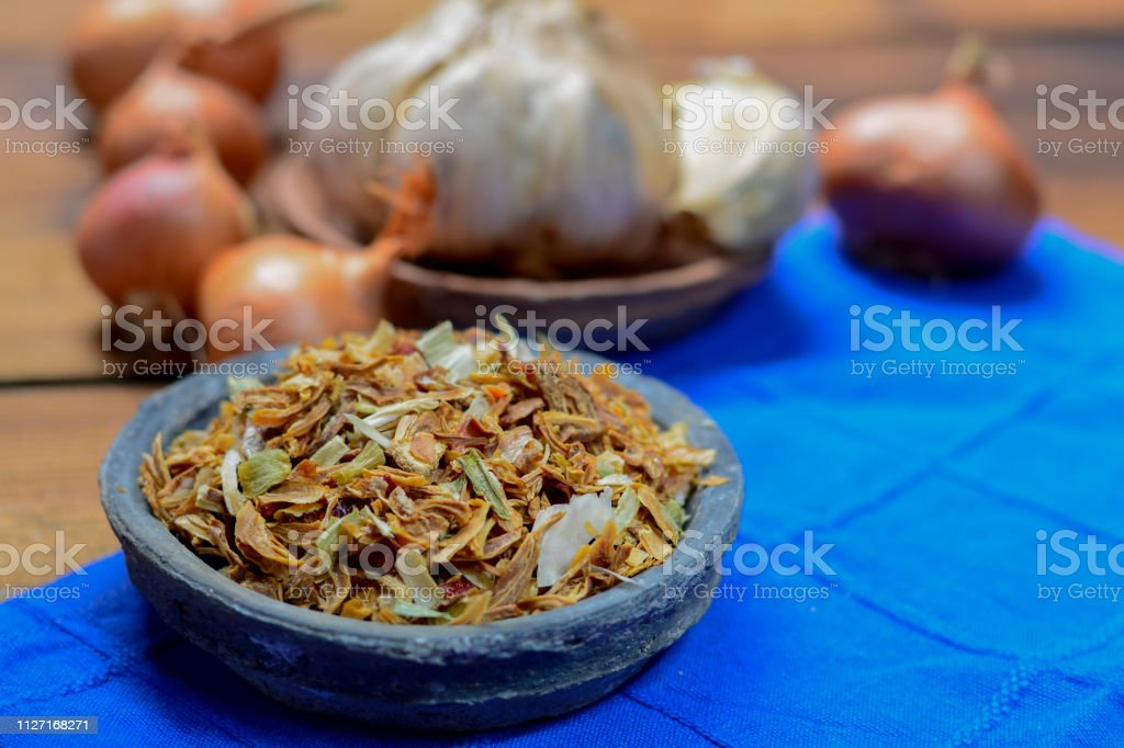 Bowl with traditional dried nasi herbs, used for cooking, close up