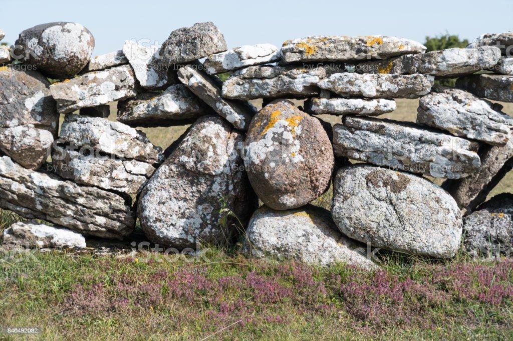 Traditional dry stone wall closeup stock photo