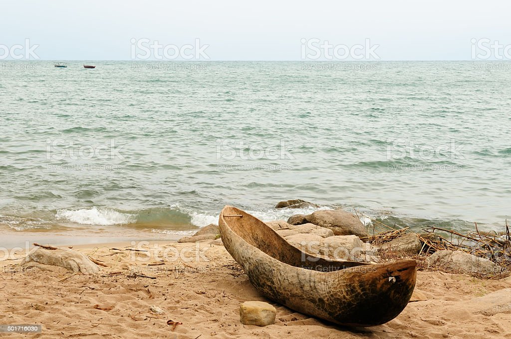 Traditional dugout canoe on the beach on the lake Malawi stock photo
