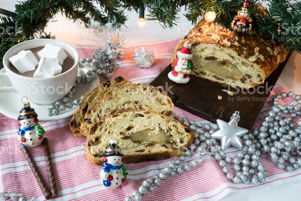 traditional Dutch and German kerststol, as Christmas bread, hot chocolate, decorations stock photo