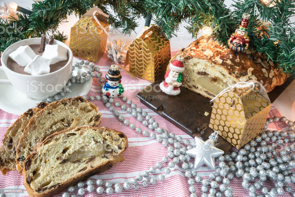 traditional Dutch and German kerststol, as Christmas bread, hot chocolate, with golden presents stock photo