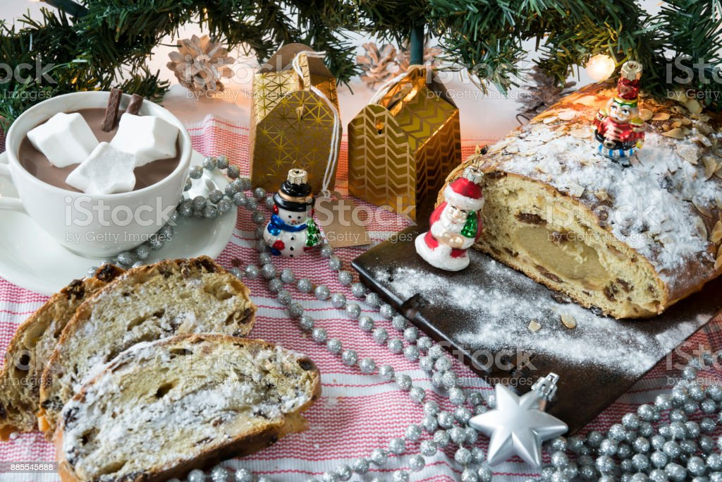 traditional Dutch and German kerststol, as Christmas bread, with golden presents stock photo