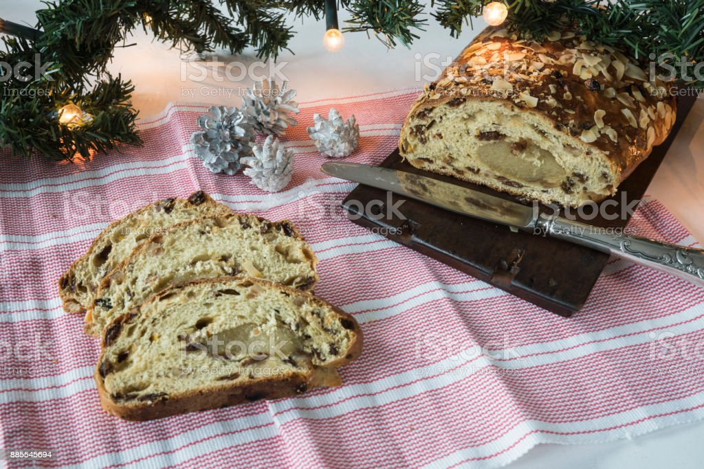 traditional Dutch and German kerststol, as Christmas bread, with decorations, twig, stock photo