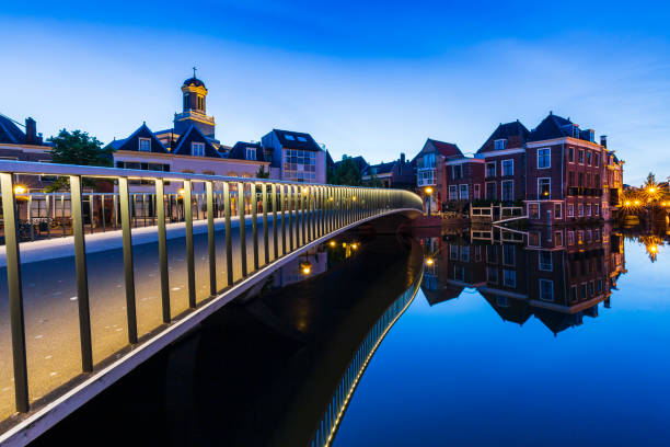 Traditional Dutch culture houses and canal during dusk in Leiden, Holland Traditional Dutch culture architecture houses and canal during the blue hour. Historical and touristic town Leiden, the Netherlands leiden stock pictures, royalty-free photos & images