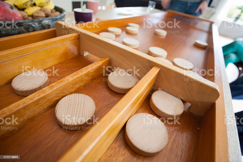 Traditional Dutch game called 'sjoelen'. The wooden disks hove stock photo