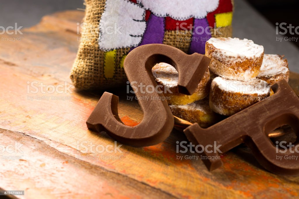 Traditional Dutch Saint Nicolas celebration with presents for children in December, Saint Nicolas  gift bag and chocolate letters stock photo