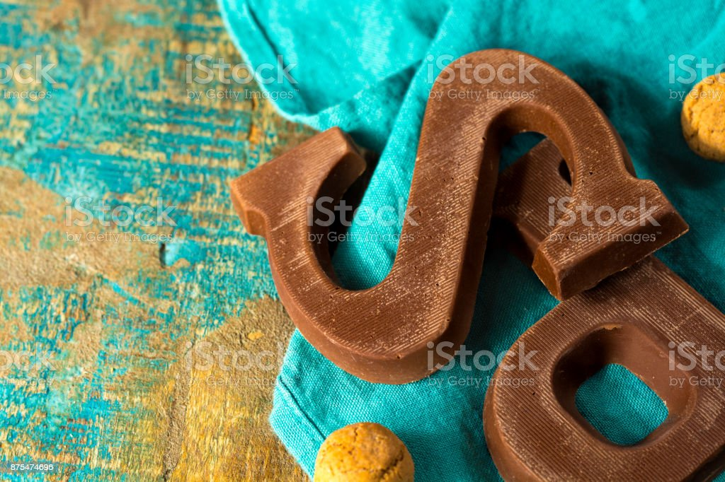 Traditional Dutch Saint Nicolas celebration with presents for children in December, Saint Nicolas chocolate letter and spicy cookies stock photo