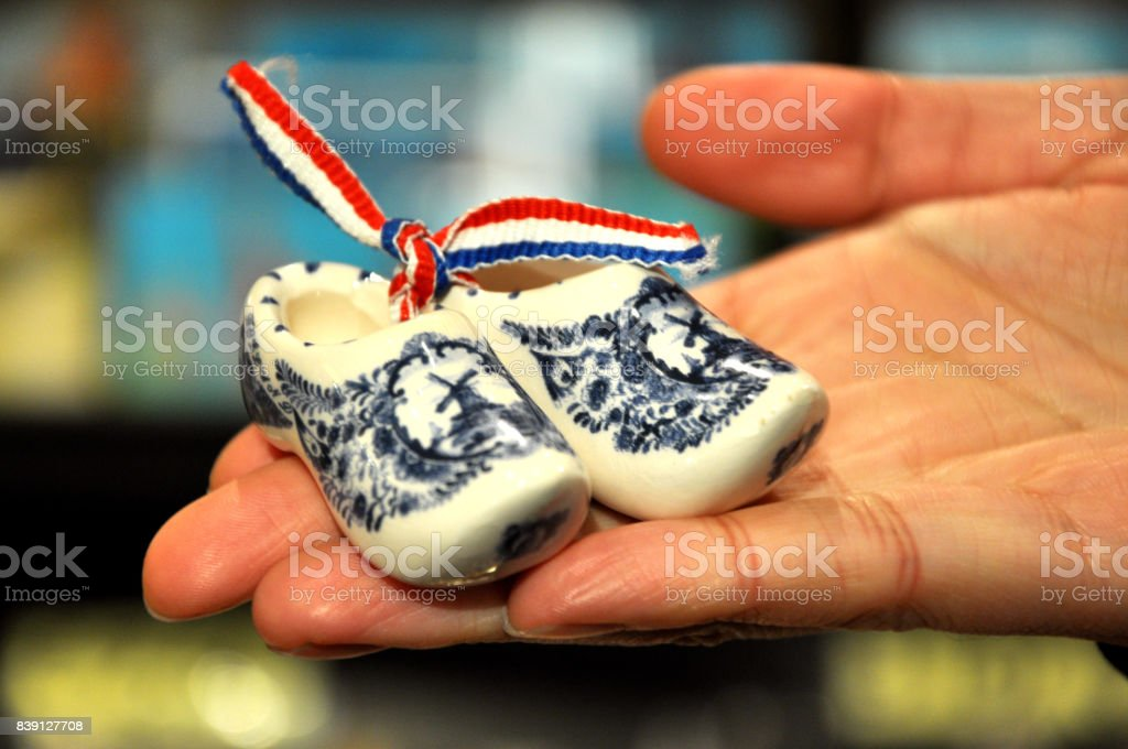 Traditional dutch shoes mounted on wooden wall stock photo