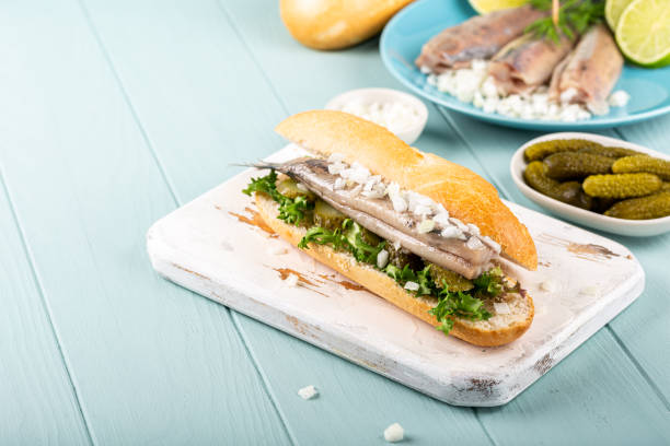 Traditional dutch snack, seafood sandwich with herring stock photo
