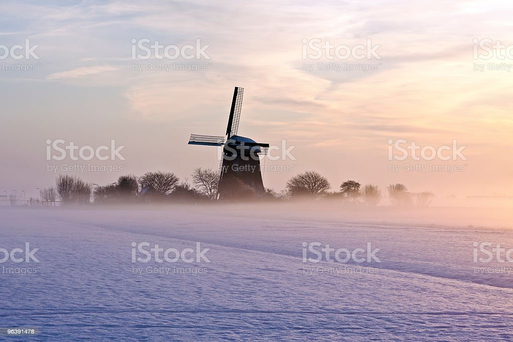 Traditional dutch windmill in wintertime the Netherlands - Royalty-free Agricultural Field Stock Photo