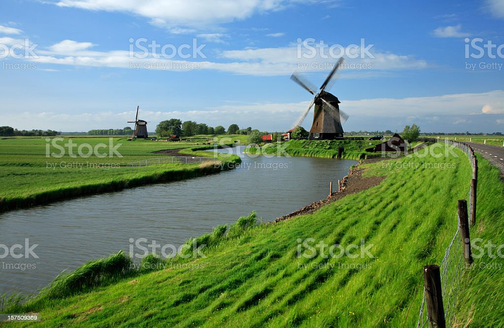 Traditional Dutch Windmill on a canal royalty-free stock photo
