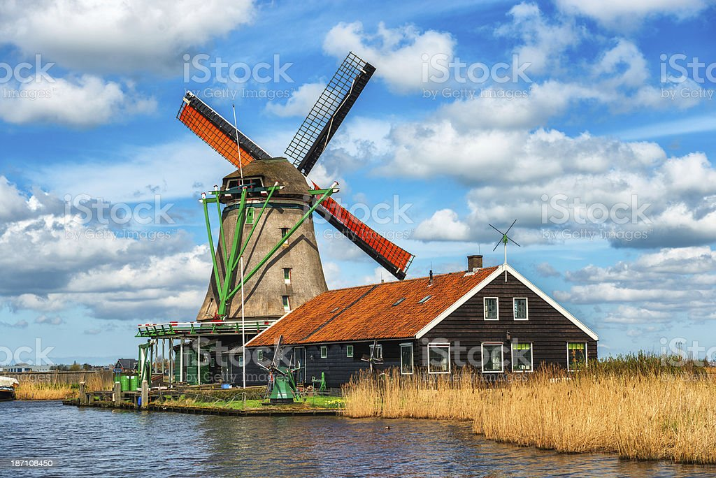 Traditional Dutch Windmill on a Typical Canal in Netherlands royalty-free stock photo