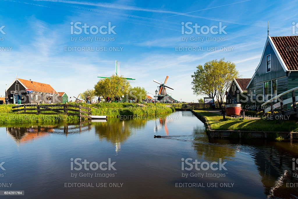 Traditional Dutch windmills and houses in Zaanse Schans, stock photo