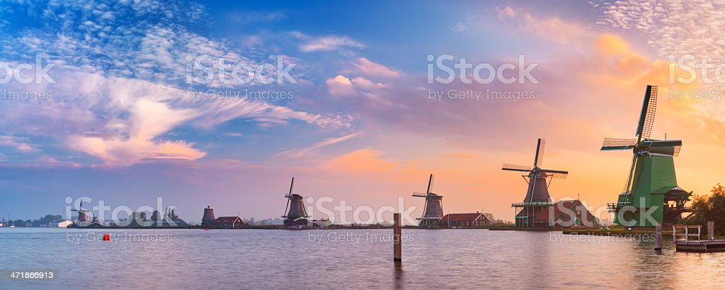 Traditional Dutch windmills at the 'Zaanse Schans', at sunrise stock photo