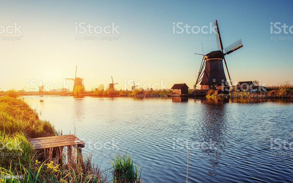 Traditional Dutch windmills from the channel Rotterdam. Holland. stock photo