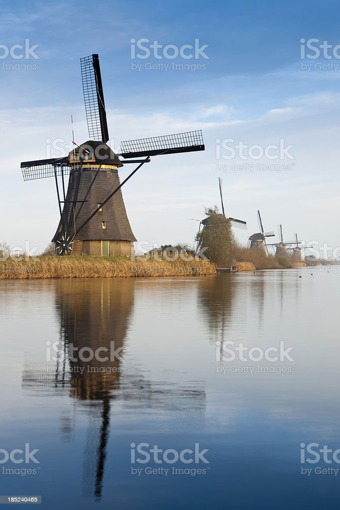 traditional Dutch windmills in a row at Kinderdijk royalty-free stock photo