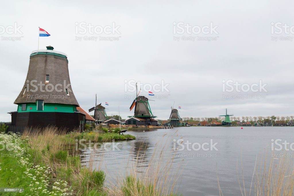 Traditional Dutch windmills in Zaanse Schans, Holland stock photo