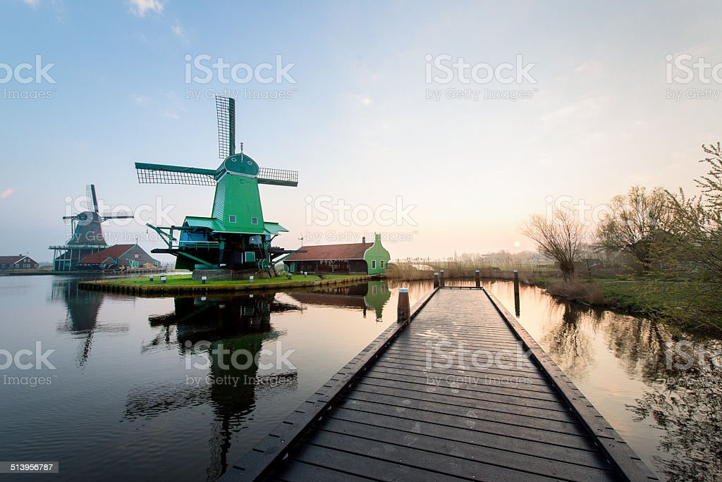 Traditional Dutch windmills just before sunrise stock photo