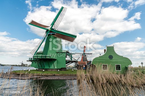 four windmills near the waterfront in the Netherlands