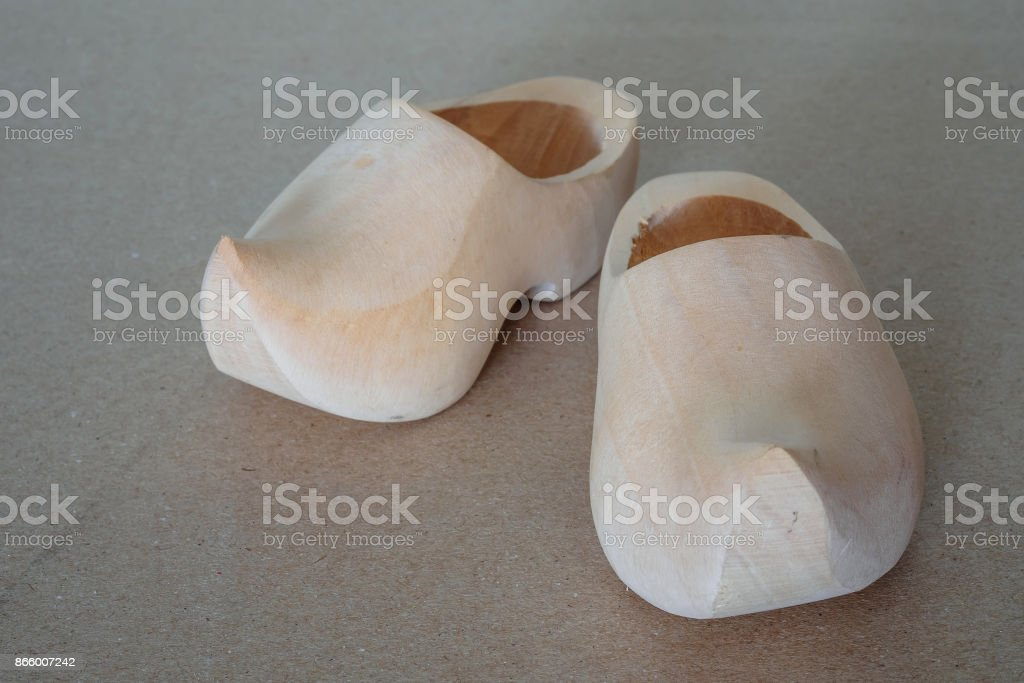 Traditional Dutch wooden handmade shoes type clogs, prepared for finishing stock photo