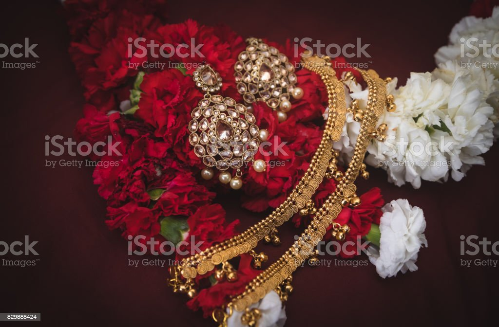 Traditional East Indian Wedding Jewelry On Flowers Stock Photo