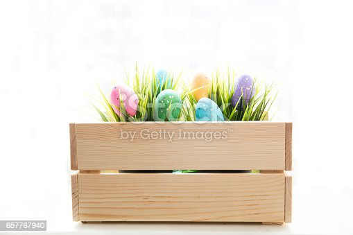 istock Traditional Easter  eggs inside a wooden crate 657767940
