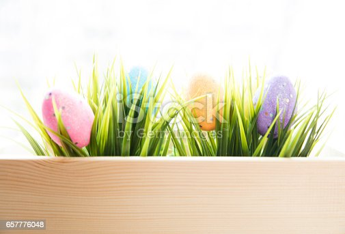 istock Traditional Easter  eggs inside a wooden crate 657776048