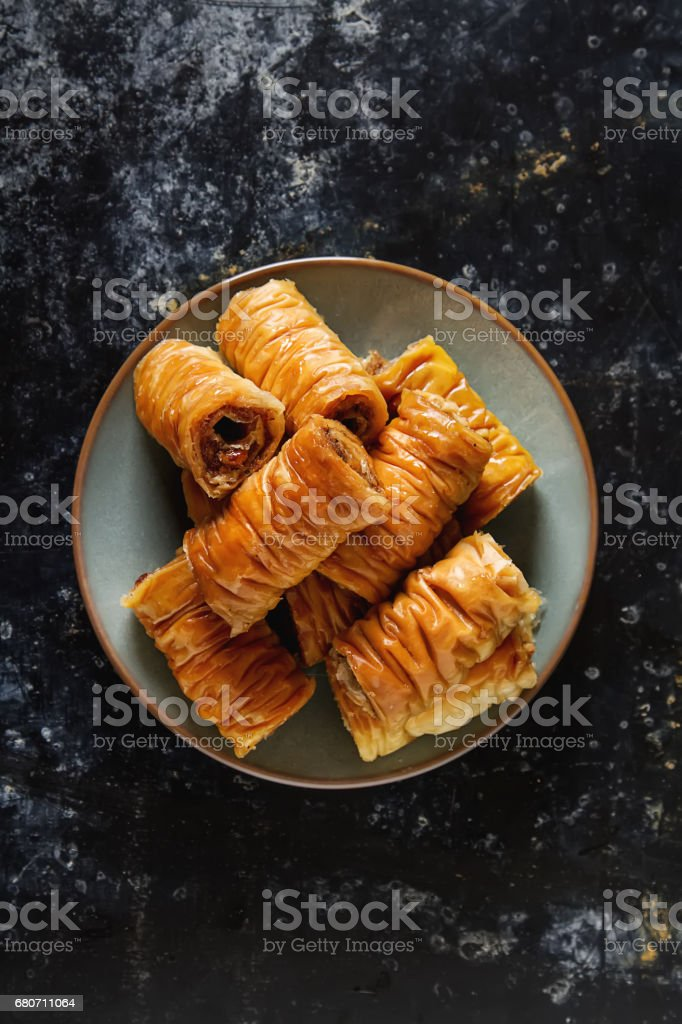 Traditional eastern arabic dessert Baklava with Turkish honey and walnuts, selective focus. Copy space. Top view stock photo