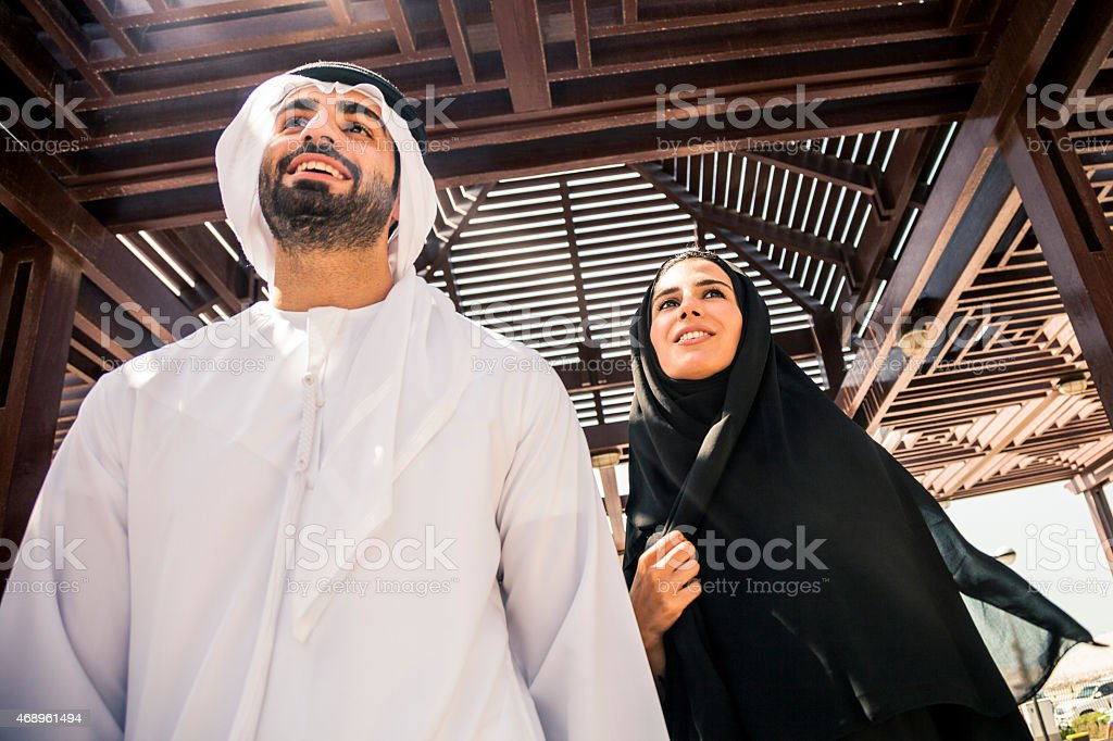 Traditional Emirati young couple enjoying life outdoor stock photo