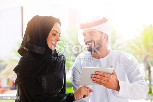 istock Traditional Emirati young family surfing in Internet 469577834
