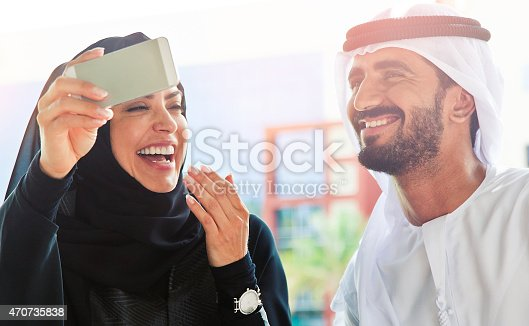 istock Traditional Emirati young family taking a selfie 470735838