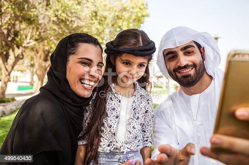 472869308 istock photo Traditional Emirati young family taking a selfie 499540430
