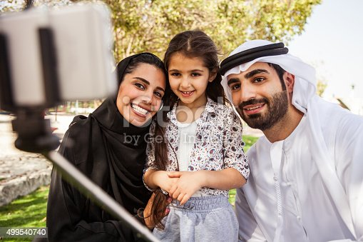 472869308 istock photo Traditional Emirati young family taking a selfie 499540740