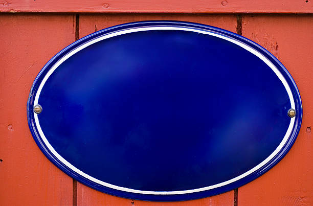 traditional enamel dark blue oval sign with copy space - enamel stock photos and pictures